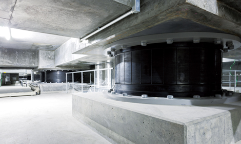 Seismic isolation system coupled with a building safety diagnostic system in the Shimizu head office building that determines whether it is safe to use the building immediately after an earthquake